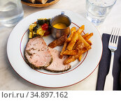 Pork loin with french fries and vegetables. Стоковое фото, фотограф Яков Филимонов / Фотобанк Лори