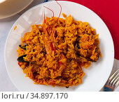 Plate of tasty seafood paella with rice, mussels and shrimps. Стоковое фото, фотограф Яков Филимонов / Фотобанк Лори
