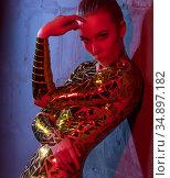 Gorgeous blonde with gold tape body art view. Стоковое фото, фотограф Гурьянов Андрей / Фотобанк Лори