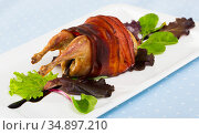 Image of baked in bacon quail with balsamic sauce on the plate. Стоковое фото, фотограф Яков Филимонов / Фотобанк Лори