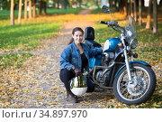 Beautiful motorcycle brunette woman with a big classic motorcycle, copy space. Стоковое фото, фотограф Кекяляйнен Андрей / Фотобанк Лори