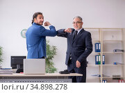 Two employees at workplace during pandemic. Стоковое фото, фотограф Elnur / Фотобанк Лори