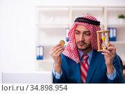 Young male arab employee working in office. Стоковое фото, фотограф Elnur / Фотобанк Лори