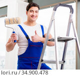 Painter repairman working at construction site. Стоковое фото, фотограф Elnur / Фотобанк Лори