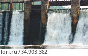 Water dam in the forest - heavy water stream falls down the brick wall. Стоковое видео, видеограф Константин Шишкин / Фотобанк Лори
