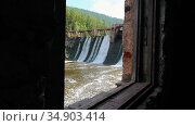 Water dam in the the forest - water falls down - looking out of the window. Стоковое видео, видеограф Константин Шишкин / Фотобанк Лори