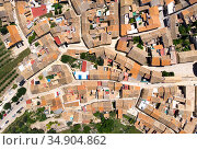 Directly from above view ancient houses rooftops and roads, view from top. Montesa village. Spain. Стоковое фото, фотограф Alexander Tihonovs / Фотобанк Лори