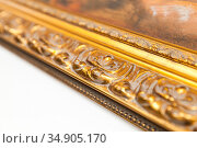 Ancient vintage golden frame fragment, wooden carving. Стоковое фото, фотограф EugeneSergeev / Фотобанк Лори