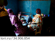 Girl rests while being treated for malaria in the small rural hospital in Moukoulou, southern Chad. Her family watches over her. Malaria disease is very... Стоковое фото, фотограф Enrique Lopez-Tapia / Nature Picture Library / Фотобанк Лори