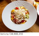 Shopska salad - dish of Balkan cuisine. Cucumbers, tomatoes, bell peppers and brynza. Стоковое фото, фотограф Яков Филимонов / Фотобанк Лори