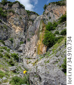 Man talking on the phone on the background waterfall in the Athamanian mountains (region Tzoumerka, Greece) Стоковое фото, фотограф Татьяна Ляпи / Фотобанк Лори