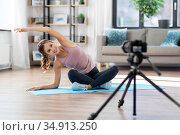 woman or sports blogger streaming online yoga. Стоковое фото, фотограф Syda Productions / Фотобанк Лори