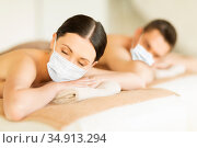 couple in masks at spa. Стоковое фото, фотограф Syda Productions / Фотобанк Лори