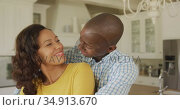 An African American couple spending time at home together. Стоковое видео, агентство Wavebreak Media / Фотобанк Лори