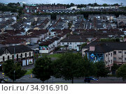 Great Britain, Derry - Catholic district of Bogside, which plays a special role in the Northern Ireland conflict, in the picture also Catholic Wall Murals (2019 год). Редакционное фото, агентство Caro Photoagency / Фотобанк Лори