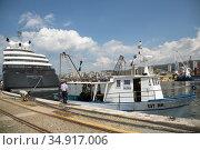 Croatia, Rijeka - fishing boat, next to it the super yacht Scenic Eclipse. Редакционное фото, агентство Caro Photoagency / Фотобанк Лори