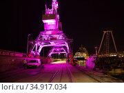 Croatia, Rijeka - lighted loading cranes on the pier, on the right fishing boat, behind mega yacht. Редакционное фото, агентство Caro Photoagency / Фотобанк Лори