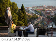 Croatia, Rijeka - The Trsat Castle, situated above the city in the mountain, is a historical, rebuilt castle with a cafe in the courtyard, view of the city center and port. Редакционное фото, агентство Caro Photoagency / Фотобанк Лори