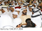 Dubai, United Arab Emirates, Sheikh Mohammed bin Rashid al Maktoum (in yellow), Head of the Emirate of Dubai (2019 год). Редакционное фото, агентство Caro Photoagency / Фотобанк Лори