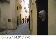 Fez, Morocco, street scene in the historic old town with its narrow streets (2010 год). Редакционное фото, агентство Caro Photoagency / Фотобанк Лори