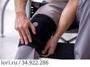 Young leg injured man in wheel-chair. Стоковое фото, фотограф Elnur / Фотобанк Лори