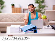 Young man working from house during pandemic. Стоковое фото, фотограф Elnur / Фотобанк Лори