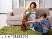 Young father and his son with cocker spaniel dog. Стоковое фото, фотограф Elnur / Фотобанк Лори