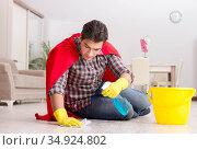 Super hero husband cleaning floor at home. Стоковое фото, фотограф Elnur / Фотобанк Лори