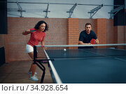 Man and woman play doubles table tennis, ping pong. Стоковое фото, фотограф Tryapitsyn Sergiy / Фотобанк Лори