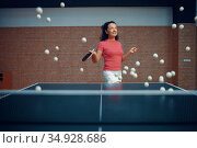 Woman among flying ping pong balls, table tennis. Стоковое фото, фотограф Tryapitsyn Sergiy / Фотобанк Лори