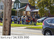 Detroit, Michigan - Missionaries with the Neocatechumenal Way lead... Редакционное фото, фотограф Jim West / age Fotostock / Фотобанк Лори