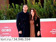 Gabriele Mainetti with fiancee Alice Vicario on Red carpet at the... Редакционное фото, фотограф Maria Laura Antonelli / AGF/Maria Laura Antonelli / age Fotostock / Фотобанк Лори