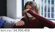 Woman wearing face mask sneezing on her elbow. Стоковое видео, агентство Wavebreak Media / Фотобанк Лори