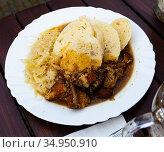 Braised pork and cabbage with potato dumplings. Стоковое фото, фотограф Яков Филимонов / Фотобанк Лори