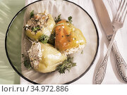 Delicious dish: stuffed bell pepper on a plate. Стоковое фото, фотограф Galina Tolochko / Фотобанк Лори