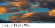 Panoramic view of dramatic colorful thunderclouds rising of sun floating in sky to change weather. Стоковое фото, фотограф А. А. Пирагис / Фотобанк Лори