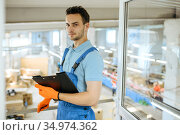 Bicycle factory, young worker with notebook. Стоковое фото, фотограф Tryapitsyn Sergiy / Фотобанк Лори