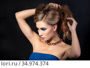 Portrait of beautiful young woman styling her hair. Стоковое фото, фотограф Людмила Дутко / Фотобанк Лори