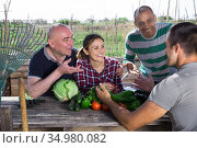 Meeting good friends at table in the backyard. Стоковое фото, фотограф Яков Филимонов / Фотобанк Лори