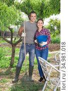 Couple of smiling amateur gardeners standing at smallholding. Стоковое фото, фотограф Яков Филимонов / Фотобанк Лори