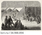 King Mutesa's guards at rations, Africa. Old XIX century engraved... Редакционное фото, фотограф Jerónimo Alba / age Fotostock / Фотобанк Лори