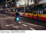 Warsaw, Poland - October 26, 2020: Line of buses after thousands ... Редакционное фото, фотограф Konrad Zelazowski / age Fotostock / Фотобанк Лори