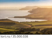 Kimmeridge Bay and the Jurassic Coast from Swyre Head, Isle of Purbeck, Dorset, England, UK, May 2020. Стоковое фото, фотограф Guy Edwardes / Nature Picture Library / Фотобанк Лори