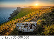 Sunset over Bat's Head from Tyneham Cap, Isle of Purbeck, Jurassic Coast World Heritage Site, Dorset, England, UK, May. Стоковое фото, фотограф Guy Edwardes / Nature Picture Library / Фотобанк Лори