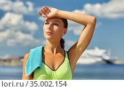 tired woman with towel after sports outdoors. Стоковое фото, фотограф Syda Productions / Фотобанк Лори