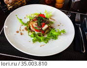 Codfish timbale with fried red peppers, arugula, olive oil. Стоковое фото, фотограф Яков Филимонов / Фотобанк Лори
