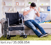 Disabled man recovering at home. Стоковое фото, фотограф Elnur / Фотобанк Лори