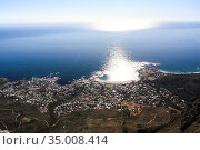 Sun over the ocean, water glare and a view of one of the districts of Cape town (2009 год). Стоковое фото, фотограф Олег Елагин / Фотобанк Лори