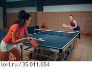 Women play ping pong match, table tennis. Стоковое фото, фотограф Tryapitsyn Sergiy / Фотобанк Лори