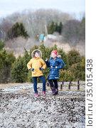 Portrait of two young girls walking together, warm clothing at winter season. Стоковое фото, фотограф Кекяляйнен Андрей / Фотобанк Лори